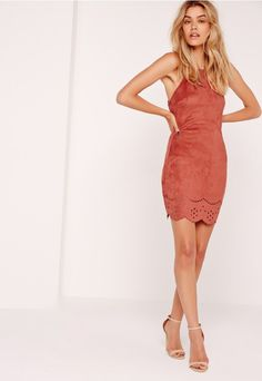 Remix your wardrobe and rewind back to the 90s in this dress. In a luxe faux suede fabric, 90s racer neck, chic cross back straps, laser cut deets across the hem and a burnt orange hue, you'll be raising the temps whenever and whenever. Tea...