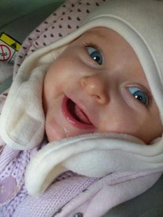 Sweet, happy baby. Is there anything more sweet than a baby's smile and laugh?