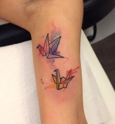 Forearm tattoo of an origami crane with a watercolor for Studio 42 tattoo