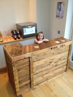 """My first attempt at building anything, pallets came from neighbours, and I bought some 2"""" by 2"""" for the frame and added in some chipboard shelves. Two pieces clamped together, and the bar top screwed down in three places."""