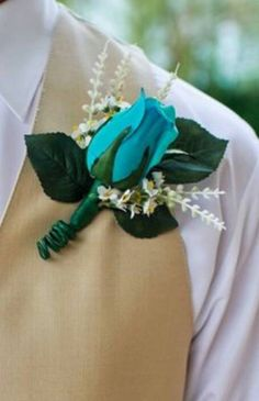 This is a turquoise rose boutonniere. This comes complete with attachment pins.