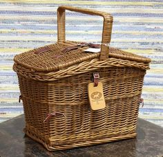 English wicker picnic basket, the hinged top with leather buckles, opening to the interior fitted with service for two, and with a T... - Price Estimate: $100 - $200