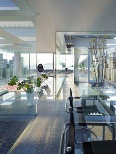Strikingly Creative Glass Home Hidden Behind Concrete Blocks