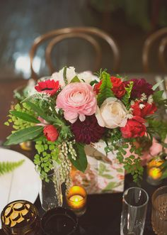 red, pink and white rustic yet chic wedding centerpiece with fern accents   photo: the weaver design