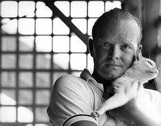 Truman Capote and his cat.