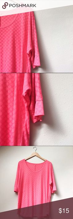Maurices Coral Top Coral pink top with mid-length sleeves; polka dot pattern in the same color adds a subtle layer of texture and interest. Good used condition, with minimal pilling across the entire surface that does not affect wearability. Maurices Tops