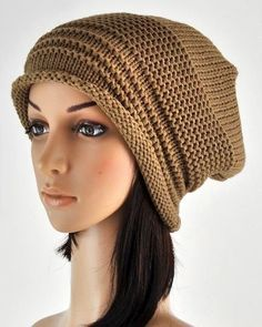 """Cuddle up this fall and winter with our new winter caps.  This Cable Knit Baggy Beanie will quickly become your new favorite: super warm and super cute! One of those """"great to wear, easy to care"""" items in your wardrobe that you just don't want to take off."""
