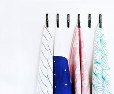 Hang up tea towels using simple clothes pins.