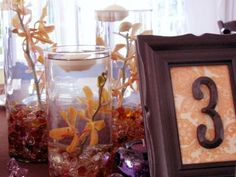 Beautiful DIY centerpiece. Pick up the frames, vases, and clear luster gems at Dollar Tree and save!