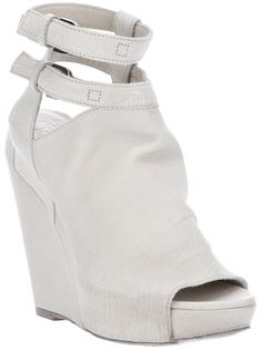 White leather sandals from Cinzia Araia featuring two ankle straps with buckle fastenings and a round open toe.
