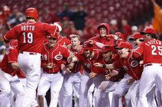 CINCINNATI, OH - MAY 13: Joey Votto #19 of the Cincinnati Reds celebrates with teammates after hitting a grand slam in the ninth inning against the Washington Nationals at Great American Ball Park on May 13, 2012 in Cincinnati, Ohio. The Reds won 9-6 as Votto hit three home runs. (Photo by Joe Robbins/Getty Images)