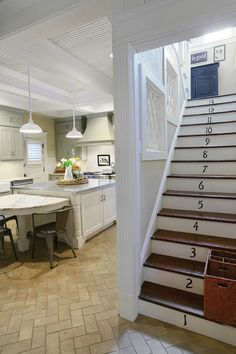 Updating an Old House for a Young Family in Missouri. Thinking I should paint the stairs like this (no numbers)