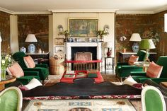 """[i]The scheme for the drawing room was designed around a set of seventeenth-century Soho tapestries, which hang on each side of the chimneypiece. An unusual painting by the French-Polish artist Balthus hangs on the adjacent wall.[/i]  Like this? Then you'll love  [link url=""""http://www.houseandgarden.co.uk/interiors/fireplace-ideas""""]Fireplace ideas[/link]"""