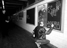 Keith Haring doodling in the subways.