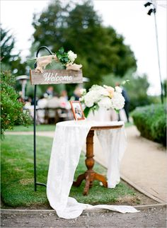 'Welcome' wedding sign: adorable for an outside wedding! Put the guest book on this table, too, so guests can sign when they arrive or when they leave.