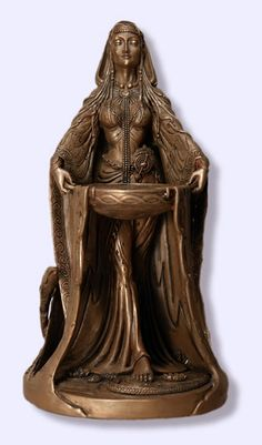 'Danu' statue by Celtic artist, Maxine Miller. Danu is thought to be the great mother of the race of the Tuatha De Danaan, the ancient tribe of the Celtic people. She is the great goddess of flowing rivers and the life force that they bring to the earth. She is associated with agriculture, cultivation, and the nurturing of the land. She represents the cycle of life, death, and rebirth.