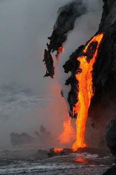 Lava flowing into the ocean from kilauea volcano (hawaii) by leigh hilbert