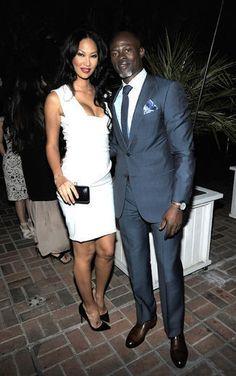 Kimora Lee Simmons and Djimon Hounsou.