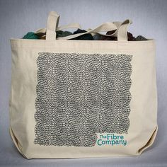 "The Fibre Co. Tote bag 100% organic cotton tote bag printed with the Fibre Company logo and a hand-drawn cable stitch pattern.  Measures 18x12x6"" (45.7x30.5x15.25 cm). Printed and sewn in the USA. - $20."