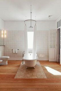 I'll never stop loving clawfoot tubs, while always futilely searching for a triple-wider curtain u-bar to go over them.