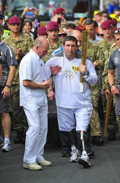 Doncaster, England    Lance Bombardier Ben Parkinson, the most seriously wounded British soldier to survive the war in Afghanistan, carries the Olympic flame through his hometown of Doncaster, England, on June 26.