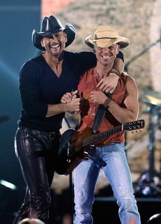 "Tim McGraw & Kenny Chesney or as I like to call them ""hot and hotter"""