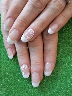 White acrylic tips with freehand gel nail art