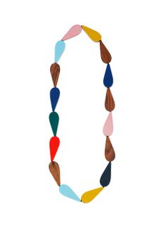 Polttopallo necklace - Marimekko Our Leikillään jewellery collection was inspired by designer Mia Maljojoki's childhood adventures. This Polttopallo necklace is combines fun and restraint.