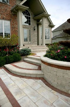 Landscaping St. Louis, Unilock paver steps and planting walls.