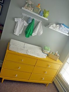 2 shelves above dresser with a hook to hang clothes    ALSO LOVE THE VINTAGE STYLE OF DRESSER AS CHANGING TABLE