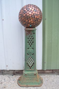 Penny bowling ball on a antique iron stand.