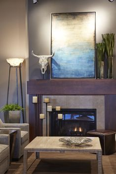 Just because you have space on your mantle, doesn't mean you have to fill it! Your fireplace is the focal point of a room, so make the fireplace your statement. Artwork, a mirror and objects with clean lines make a design that pops on your mantle.