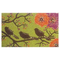 Placed on your front porch or patio, this eye-catching coir doormat welcomes guests in charming style with its lovely perched bird and floral motif.