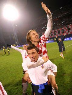 Luka Modric and Mario Mandzukic - Flying high: Croatia's Luka Modric (top) and Mario Mandzukic celebrate their win over Iceland.  AFP: Dimitar Dilkoff