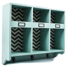 Turquoise & Chevron Wood Shelf with Slots & Hooks  this might look good, can even hang first place ribbons from the hooks