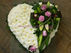 Solid heart with lilies and roses..