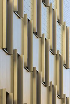 """Passage de Melun by Gaëtan Le Penhuel Architecture, Paris, France. The scheme is enveloped in an iridescent metal """"skin"""" (made up of 50 cm wide by 2.60m high cladding panels in Gold Perla powder-coated aluminium, produced by Arcelor Mittal) which changes colour according to the variations of light and the seasons.:"""