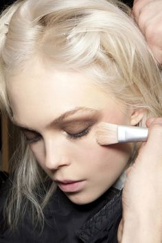 Makeup. Love the dark shadow with bleach blonde hair