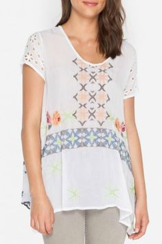 Simple handkerchief t-shirt style blouse with trapeze hemline and colorful embroidery.  Wilson Tunic by Johnny Was. Clothing - Tops - Tunics Dallas Texas