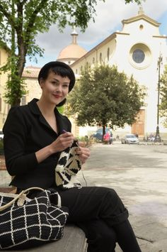 Molla Mills at work with her crochet hook in Florence's piazza Santo Spirito