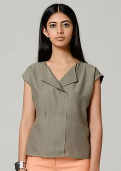 Hand woven silk grey shirt shirt BT This Boxy Hand woven shirt is cool, and we decided to give it a drape with this luxurious, handwoven matka silk. Great for days at work with dinner plans. * Olive grey *100% Hand woven *Matka silk *Short sleeves with shawl collar * Overlapping Panel