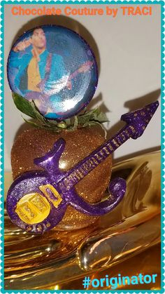 Chocolate Couture by TRACI... Tribute too PRINCE  Prince chocolate cvrd Strawberry w/ edible picks..   All Edible!! U.S. PATENT 20120368742 (Decorative Toothpick Mold)