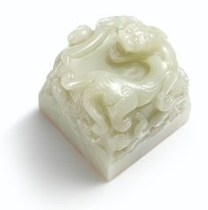 AN EXTREMELY RARE IMPERIAL WHITE JADE 'YONGZHENG YUBI ZHI BAO' SEAL WITH IVORY-INLAID BOX AND COVER THE SEAL: QING DYNASTY, KANGXI PERIOD THE SEAL FACE: QING DYNASTY, YONGZHENG PERIOD of square form with thick sides, surmounted by a ferocious crouching chilong with bulging eyes and curly mane, its mighty body with well-defined muscles terminating at a bushy tail, surrounded by eight further chilong of smaller size writhing amidst scrolling clouds, the square seal face crisply carved in the…