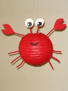 Create an adorable red crap with paper lanterns. Great for a nautical or under the sea classroom or party theme.