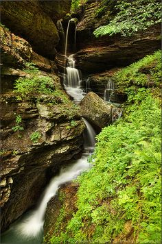Indian Creek Canyon Falls, Fayetteville, Arkansas.  A hidden treasure just off the Buffalo National River, Indian Creek's mossy waterfalls and karst canyon are best explored after heavy rains.