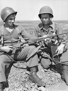 Forcemen of 5-2, First Special Service Force, with an M1941 Johnson light machine gun on the Anzio beachhead, Italy, April 1944.