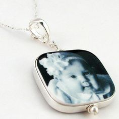 This two-sided statement piece holds your gorgeous photos; baked in a clay and sealed to a glossy, waterproof finish.