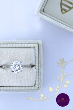 Pave set diamonds adorn the sides of this engagement ring. A 3.43 Carat F SI2 Round & 0.12 Carat diamonds on the sides mounted in beautiful 14K White Gold with a Prongs Setting. To learn more about this ring and to have actual video, please contact us. Order Now and get 30 day money back guarantee & 5 years gold warranty. | Wedding Jewelry | Engagement for Brides