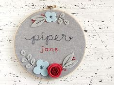8 Floral Name Hoop - Personalized Felt and Embroidery Hoop Art - Nursery Decor - New Baby Gift This personalized hoop art design features hand embroidered letters framed by a cute Floral pattern. The felt flowers are made by hand in your choice of colors (the sample in the picture