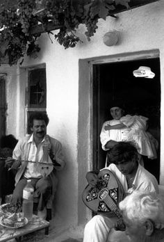 GREECE. Karpathos island. After three days of festivities, musicians singing folk tunes for the immigrants to the United States, and these who left the village for Athens (30% of the population). 1989.Image Reference © Nikos Economopoulos/Magnum Photos
